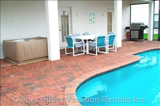Outside Covered Lanai with Dining Area, Hot Tub and Gas Bbq