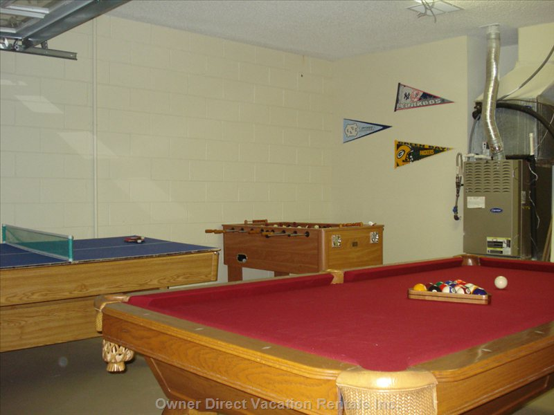 Professionally Installed Full Size Pool Table, Ping Pong Table and Fooseball.
