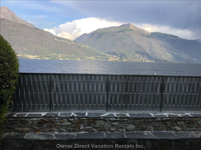 View from the Lakefront Garden and Terrace over the Privacy Fence Toward the Lake and Mountains