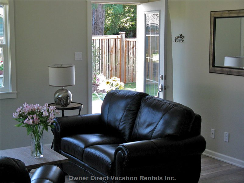 Comfy Leather Furniture with View of Entry.