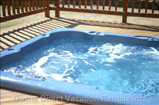 The Hottub is Situated in the Middle of a Three Tiered Deck in the Backyard