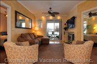 Living Room with Patio Access to Boatslip - Walk out your Door to Access your Boat, Beach, Or Bird Sanctuary.