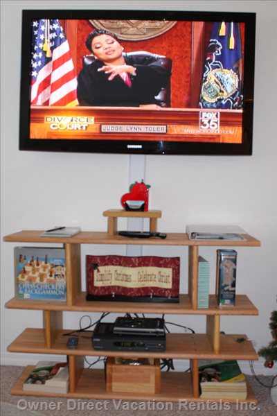 50 Inch Hdtv - Living Room with 50 Inch Hdtv, DVD Player, Games and Ottoman Too.