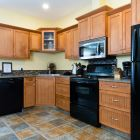 The Kitchen has Heated Tile Floors, Custom Cabinetry, and is Fully Stocked for Cooking your Meals.