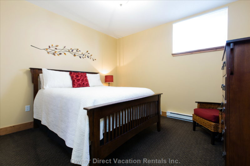 The Larger Bedroom has a Queen Bed, Dressers and Large Closet to Store your Things.