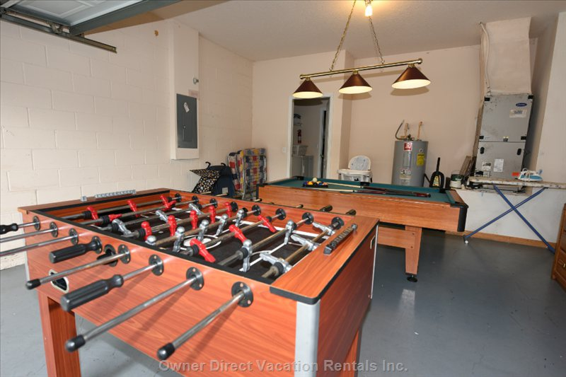 Game Room Equipped with Pool Table and Foosball Table
