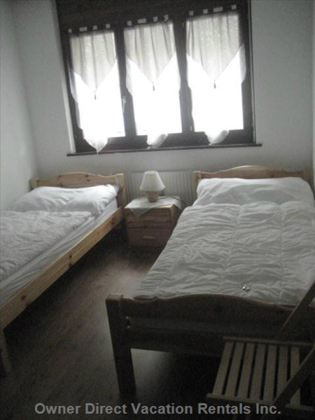 2nd Bedroom - There is a Large (3 Doors) Wardrobe that is Not Seen on the Picture and Two Chairs.