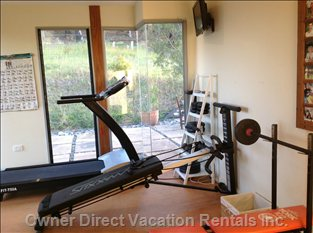 Small Fitness Room with Treadmill, Total Gym, Yoga Mat and a few Weights