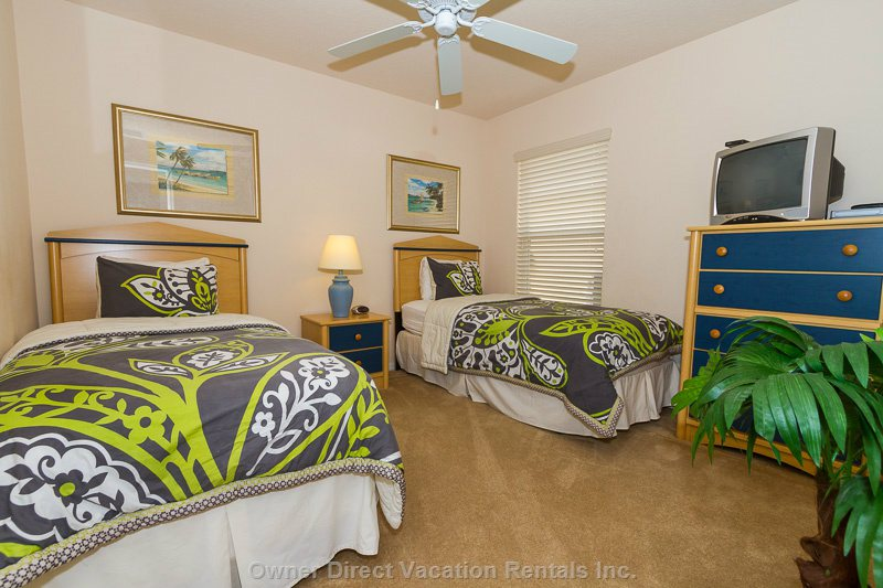 The 2nd Twin Bedroom, Again Furnished with a Tropical Theme with Palm Trees.