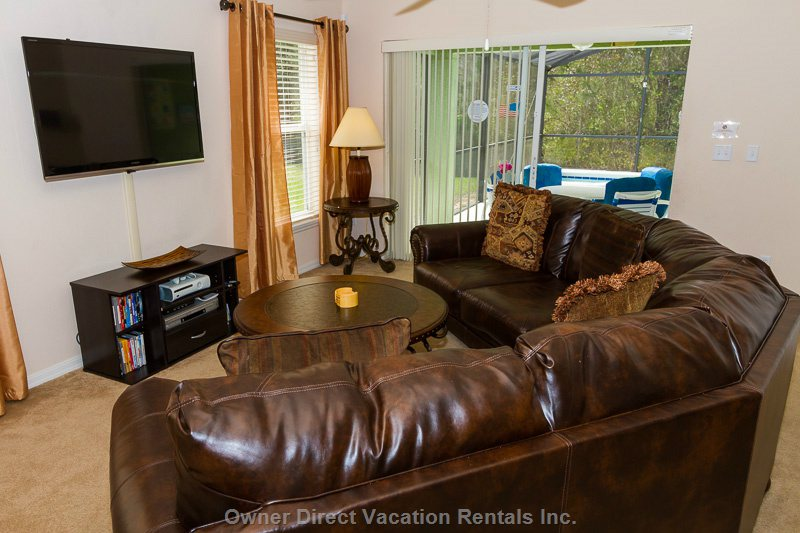 Exceptional Family Room with Designer Leather Sofa with a 55in Widescreen Internet Tv. Browse the Internet Or Watch a Movie on Netflix.
