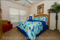 Another Tropical Theme Bedroom with Palm Tree and High Quality Bed Linens.