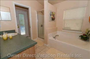 One of Three Bathrooms with Shower and Separate Bath Tub.