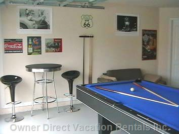 Superb Games Room - Here we Have a Huge Games Room with a Slate Bed Pool Table, Air Hockey Table, a Foosball Table, Dartsboard and a Stereo Sound System. you Can Also Relax by the Bar Table Or on the Sofa.