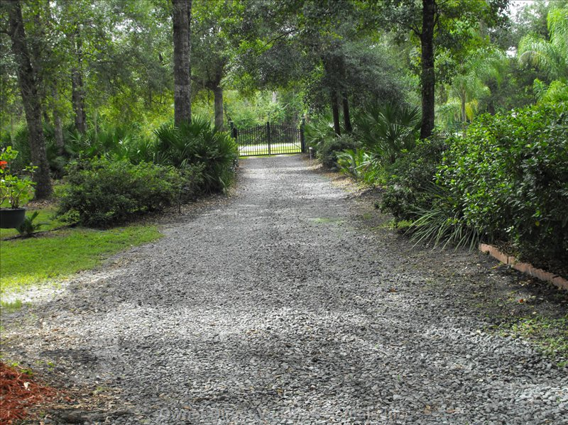 Looking down Gravel Entrance Driveway to Gate