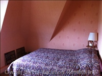 On the Third Floor, a Cute Bedroom with a Double Bed.