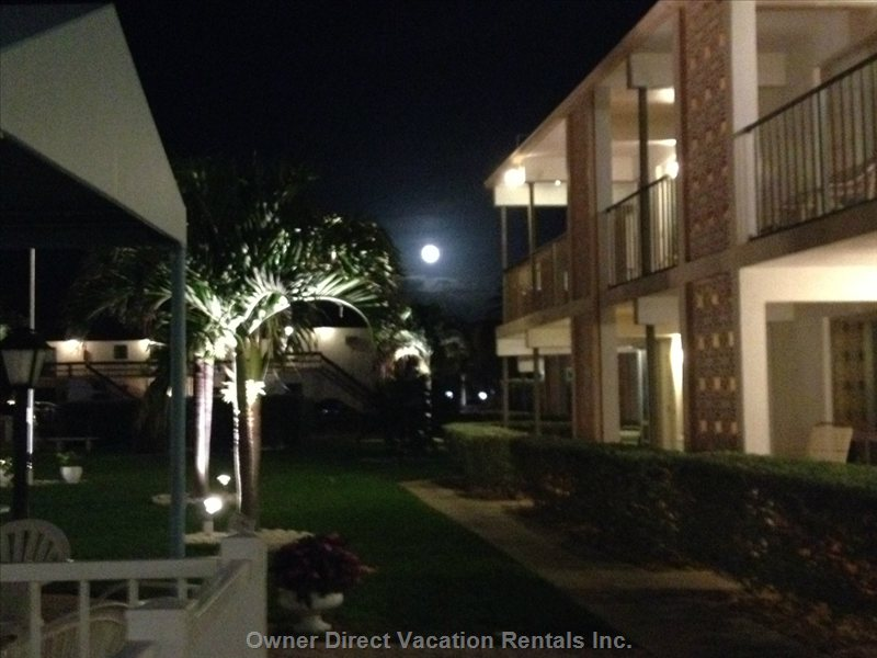 View of Central Courtyard at Night Outside of the Front of the Condo