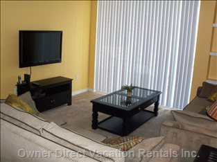 Living Room  - with Lcd TV, Two Couches, Wireless Internet and More...