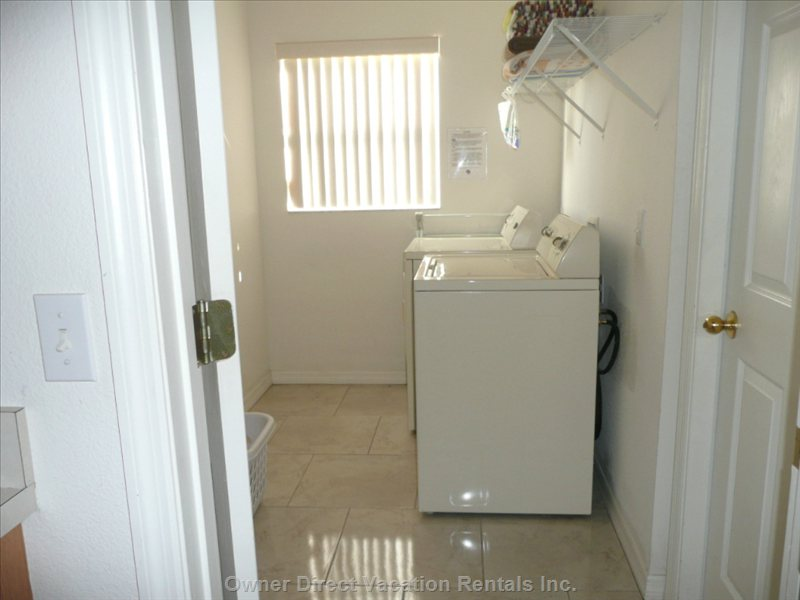 Laundry Room with Washer, Dryer, Iron Etc;