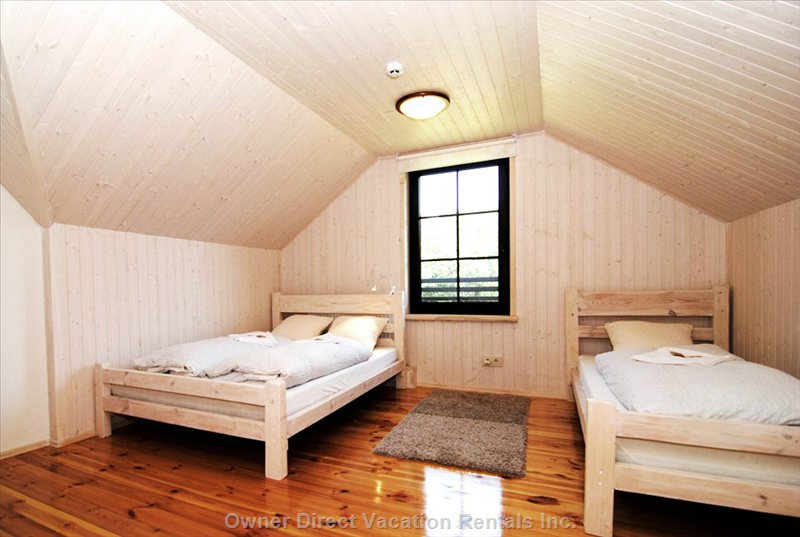 Bedroom with one Single and one Double Bed.