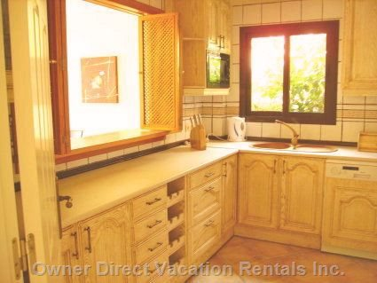 Full Equipped Kitchen with all Facilities with Dish Washer, Washing Machine, Iron - Similar to, but May Not be Exact Unit.