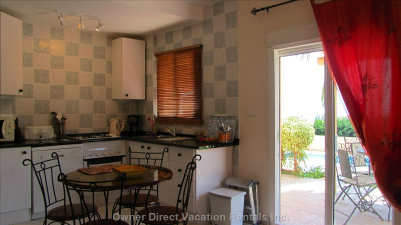 Part of the Kitchen/Diner with Slide Windows to Terrace, Garden & Pool. Great Sea View.