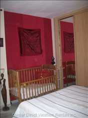 Main Family Bedroom with Double Bed & Wooden Cot, Inbuilt Wardrobes and Full Length Mirror