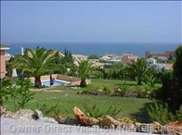 Great View from Top of Garden Showing Pool, Gardens & Sea