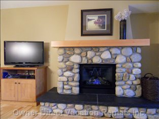 River Rock Fireplace and Lcd TV - River Rock Fireplace and Lcd TV as View from the Living/Lounge Area