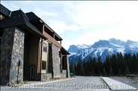 Rundle Cliffs Luxury Mountain Lodge - Rundle Cliffs Lodge with Mount Lawrence Grassi in the Background