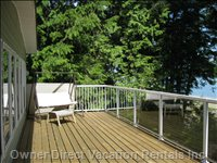 Lovely 34 Foot Deck Overlooking Oceanfront. Relax in the Comfy Lawn Chairs; New Barbecue on Deck as Well.