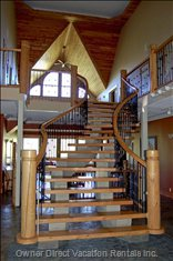 Grand Entrance & Staircase with Cathedral Ceilings.