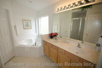 Master Bathroom (En Suite) with Large Bath, Large Walk in Shower, Walk in Closet.