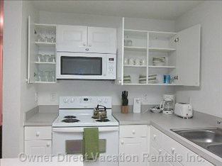 Fully Equipped Kitchen with Cookware and Silverware