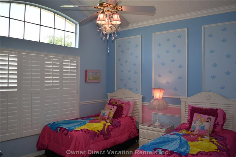 Lavishly Decorated Princess Room with Two Twin Beds, Pink Chandelier, Crown Moulding Tv and Ceiling Fan.