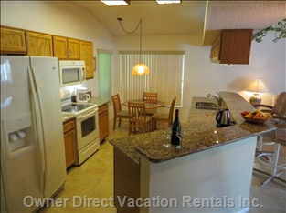 Our Large well Equipped Kitchen Overlooks the Family Room & Pool
