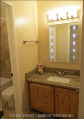 The Bathrooms Have Led Mirrors with an anti-Demisting Function and Granite Countertops