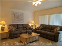 The Family Room has Electric Reclining Sofas and a Lovely Entertainment Unit