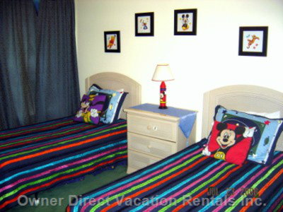 Themed Bedroom with 2 Twin Beds, Tv, Dvd Player, and Futon Couch that Sleeps an Additional 2 Guests.