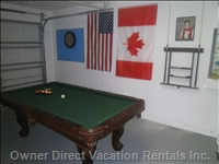Game Room with Billiard Table and Dart Board.