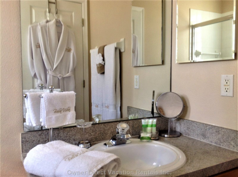 "Queen Master En-Suite Bathroom with ""hers"" and ""his"" Bathrobes"