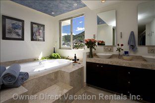 Master Bath. Aaahhhhhhh! - Master Bath has Double Sinks, Huge Walk-in Closet, Jacuzzi with Handpainted Designer Ceiling!!  another Great View of the Mountains. Also Large Marble Shower, Separate Toilet. I Have the Bubble Bath, you Bring the Wine! Hair Drier and Curler Included.