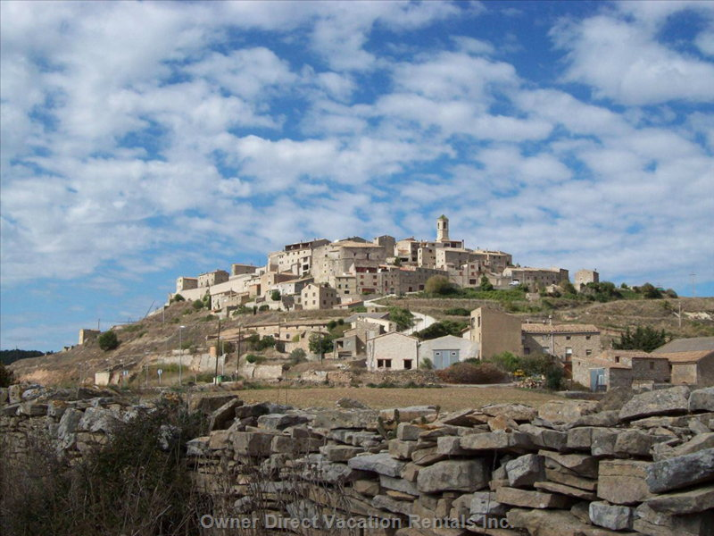 Our Hilltop Village, with Views down to the Sea, and Back over the Pyrenees