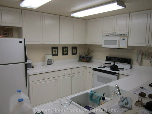 Kitchen with Range, Fridge, Dish Washer, Appliances, China and Cutlery