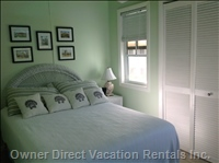 The Main Bedroom has a Double Bed and a Separate Air Conditioner.