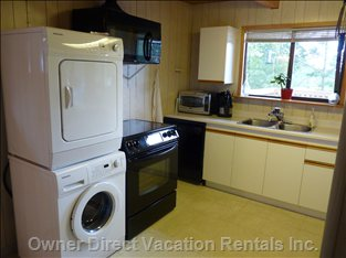 Kitchen - New Washer & Dryer, Range, Microwave and Fan, Dishwasher.