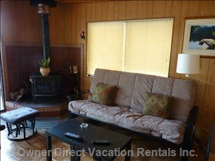 Living Room - Flat Screen TV, DVD Player, Wood Stove in Addition to Electric Baseboard Heat