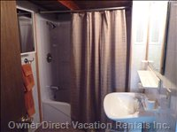 Bathroom - Tub with Shower, Toilet, and Pedestal Basin - all New Fixtures