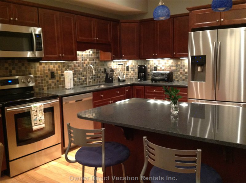 Kitchen with Island, Three Bar Stools, Refrigerator with Ice Maker, Microwave, Range, Dishwasher, Coffee Maker, Blender, Toaster Etc,