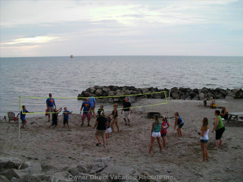 Boys versus Girls Volleyball on the Beach at the Fourth of July Party.  Who Do you Think Won?