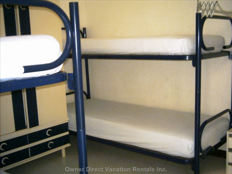 Twin Bunk Beds Sleep Four, and a Private Door Leads out to the Downstairs Patio.